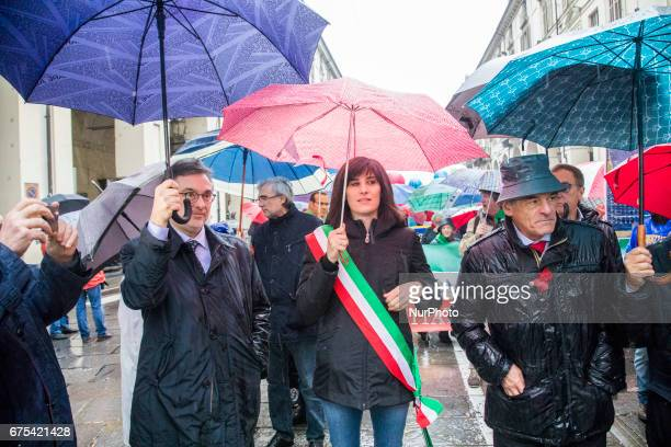 The Torino's mayor Chiara Appendino of Movimento 5 Stelle toghether with the Region Governor Chiamparino leading the Workers Day parade in Turino...