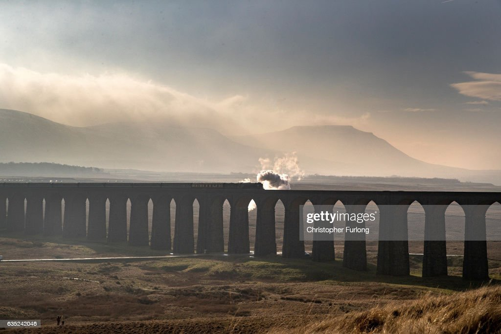 The Tornado steam locomotive pulls the first timetabled main line steam-hauled service for half a century across the Ribblehead viaduct in North Yorkshire on February 14, 2017 in Appleby, England. It is the first time in decades that a steam locomotive has been used for timetabled services on the world famous Carlisle to Settle line. The services are part of celebrations to mark the reopening of the line after landslides closed a long stretch.