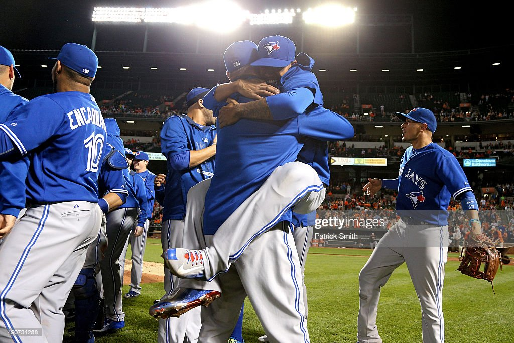 The Toronto Blue Jays celebrate after defeating the Baltimore Orioles and clinching the AL East Division during game one of a double header at Oriole...