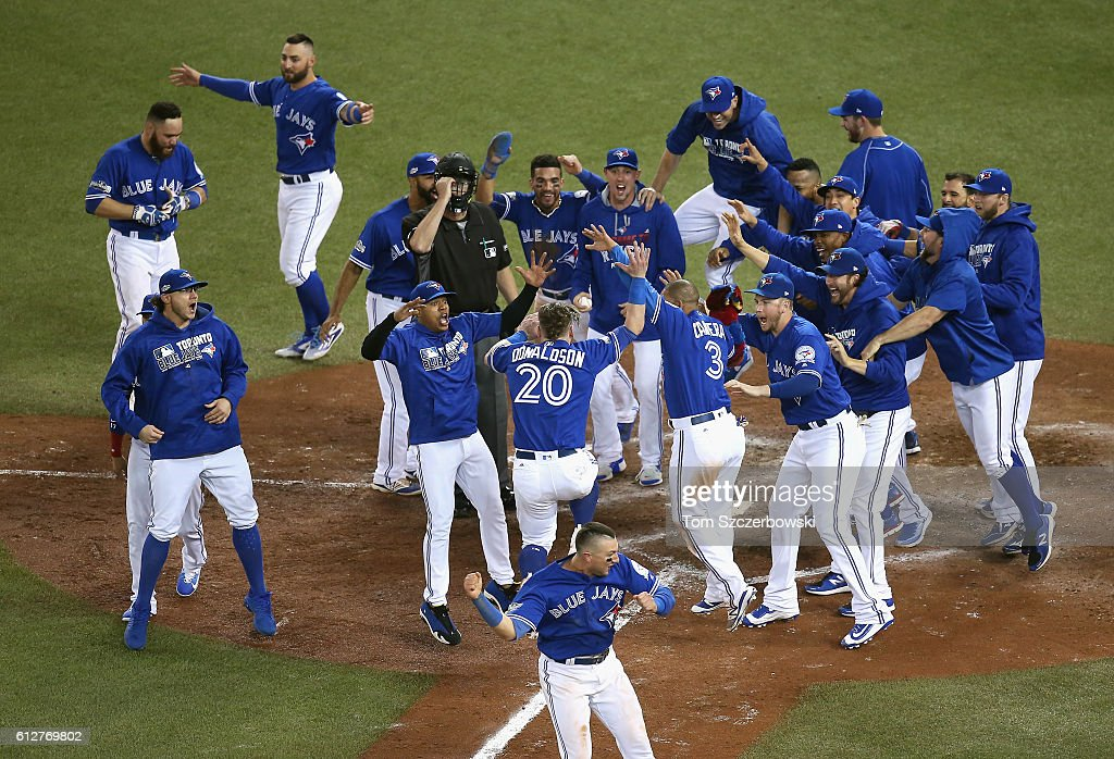 The Toronto Blue Jays celebrate defeating the Baltimore Orioles 5-2 in the eleventh inning to win the American League Wild Card game at Rogers Centre on October 4, 2016 in Toronto, Canada.