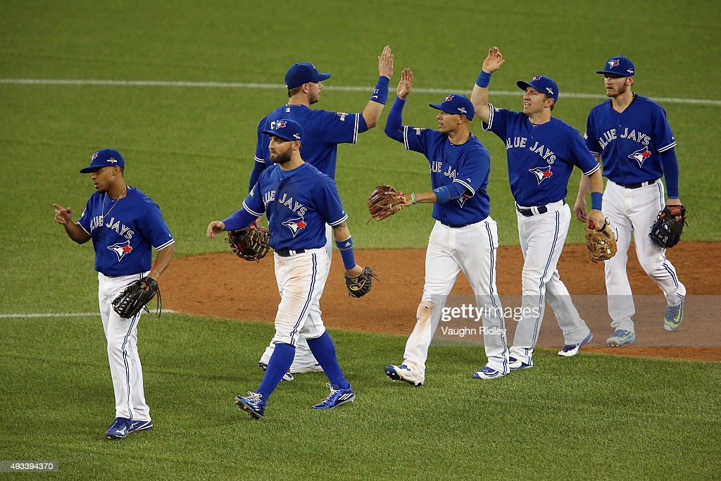 The Toronto Blue Jays celebrate defeating the Kansas City Royals 11-8 in game three of the American League Championship Series at Rogers Centre on October 19, 2015 in Toronto, Canada.