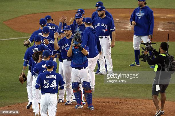 The Toronto Blue Jays celebrate defeating the Kansas City Royals 71 in game five of the American League Championship Series at Rogers Centre on...