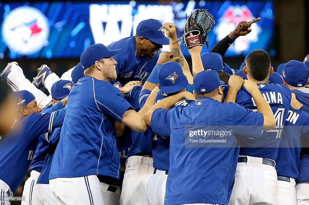 The Toronto Blue Jays celebrate the 6-3 win against the Texas Rangers as Ben Revere #7 jumps on top of the pile in game five of the American League Division Series at Rogers Centre on October 14, 2015 in Toronto, Canada.