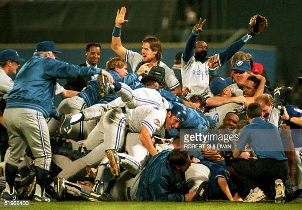 The Toronto Blue Jays celebrate their victory early 25 October 1992 after winning the 1992 World Series in Atlanta GA Blue Jays catcher Pat Borders...