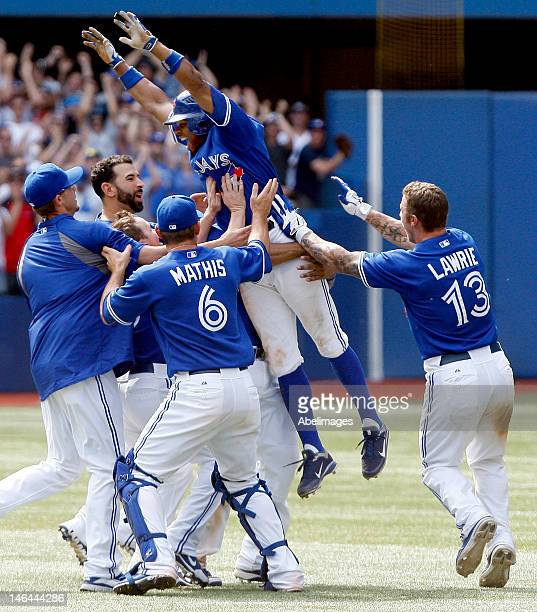 The Toronto Blue Jays hoist Rajai Davis of the Toronto Blue Jays after his game winning home run in the 10 inning during MLB action at The Rogers...