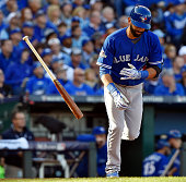 The Toronto Blue Jays' Jose Bautista tosses his bat after he flies out in the third inning against the Kansas City Royals during Game 2 of the ALCS...