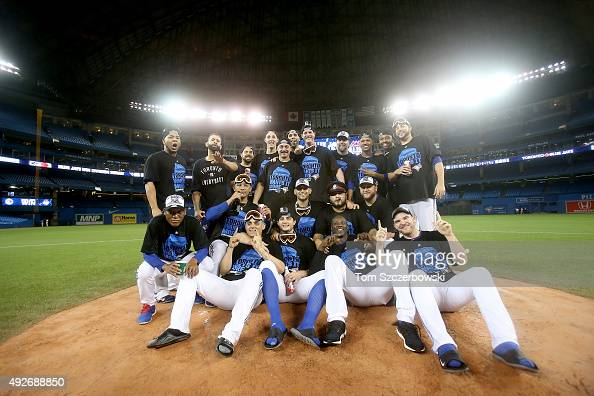 The Toronto Blue Jays pose for a team photo as they celebrate the 63 win against the Texas Rangers as Ben Revere jumps on top of the pile in game...