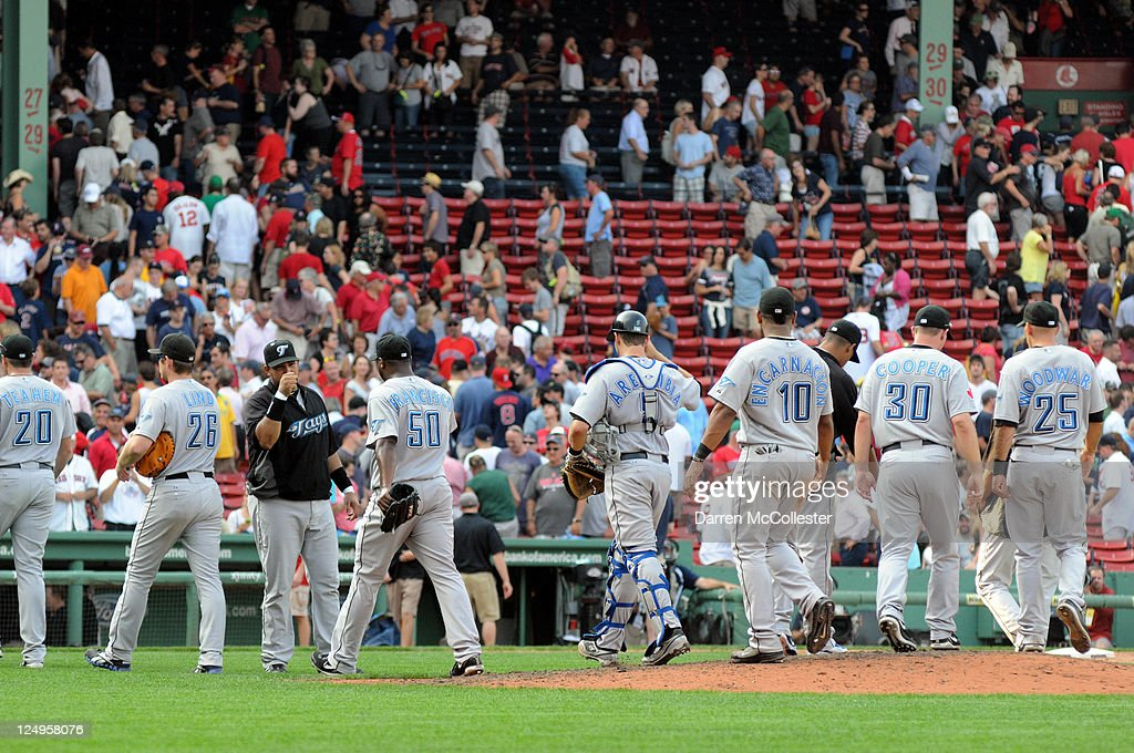The Toronto Blue Jays slap high fives after getting the final out against the Boston Red Sox at Fenway Park on September 14, 2011 in Boston, Massachusetts. The Blue Jays won 5-4.
