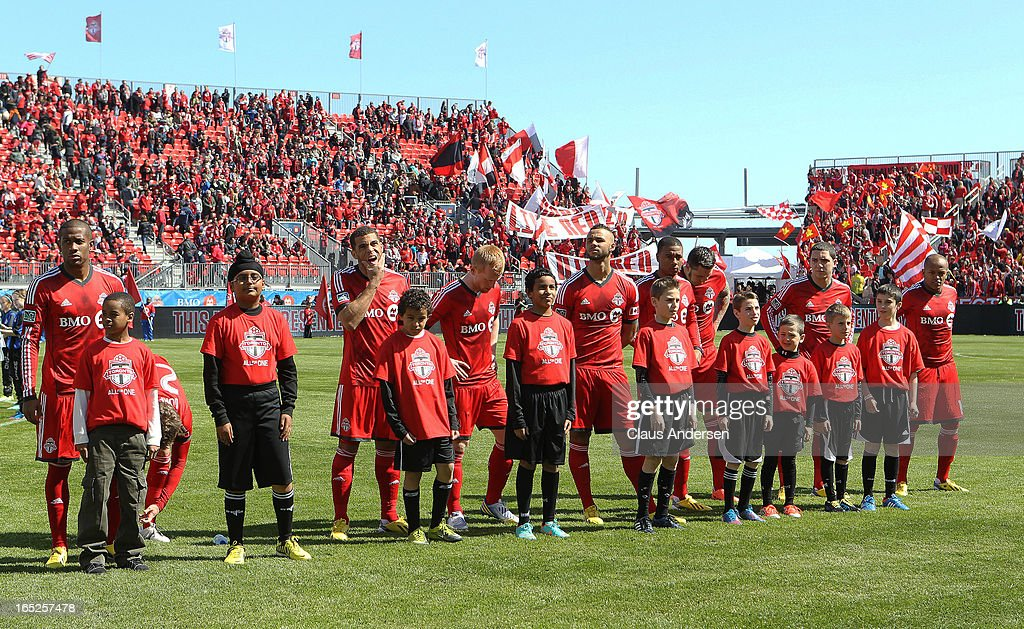The Toronto FC stand with their junior players prior to an MLS game against the LA Galaxy on March 30, 2013 at BMO field in Toronto, Ontario, Canada. The LA Galaxy and the Toronto FC played to a 2-2 tie.
