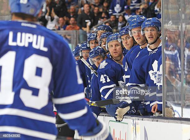 The Toronto Maple Leaf bench celebrates a goal by Joffrey Lupul against the Ottawa Senators during an NHL game at the Air Canada Centre on October 10...