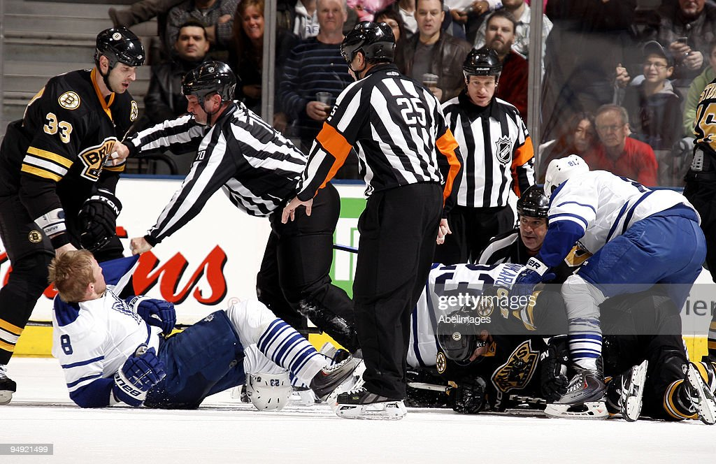 The Toronto Maple Leafs and the Boston Bruins fight after Johnny Boychuk of the Boston Bruins ran into Matt Stajan during game action December 19, 2009 at the Air Canada Centre in Toronto, Ontario, Canada.