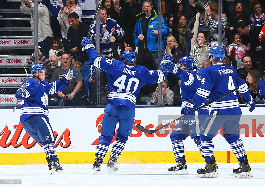 The Toronto Maple Leafs celebrate <a gi-track='captionPersonalityLinkClicked' href=/galleries/search?phrase=Mason+Raymond&family=editorial&specificpeople=4521385 ng-click='$event.stopPropagation()'>Mason Raymond</a> #12 goal against the Philadelphia Flyers during NHL action at the Air Canada Centre March 8, 2014 in Toronto, Ontario, Canada.