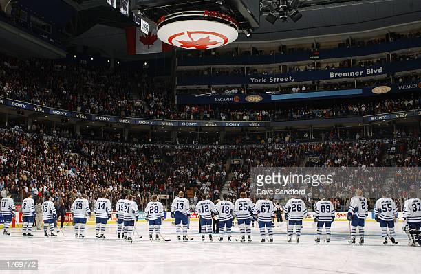 The Toronto Maple Leafs line up for the singing of the Canadien National Anthem before the game against the Philadelphia Flyers at Air Canada Centre...