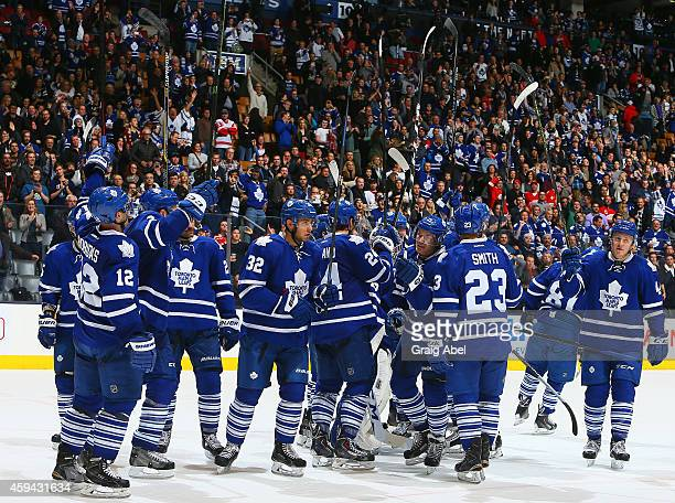 The Toronto Maple Leafs salute the fans after beating the Detroit Red Wings during NHL game action November 22 2014 at the Air Canada Centre in...
