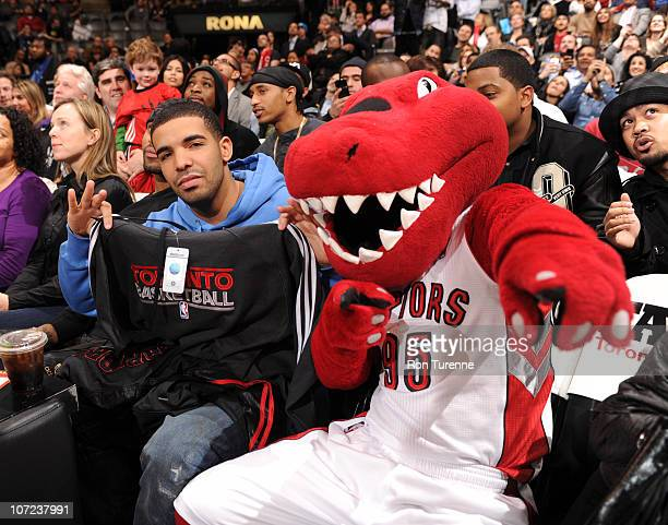 The Toronto Raptor welcomes rapper Drake courtside as the Toronto Raptors host the Washington Wizards on December 1 2010 at the Air Canada Centre in...
