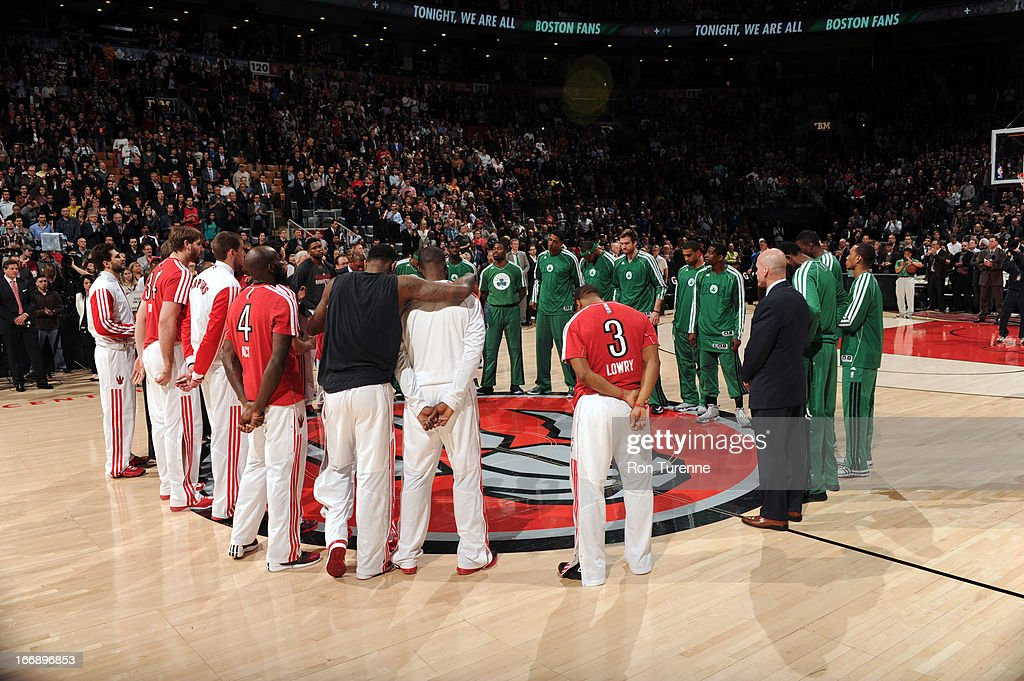 The Toronto Raptors and Boston Celtics players pause for a moment of silence for the bombing victims from the Boston Marathon before the game on April 17, 2013 at the Air Canada Centre in Toronto, Ontario, Canada.
