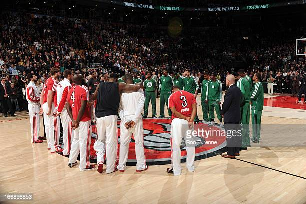 The Toronto Raptors and Boston Celtics players pause for a moment of silence for the bombing victims from the Boston Marathon before the game on...