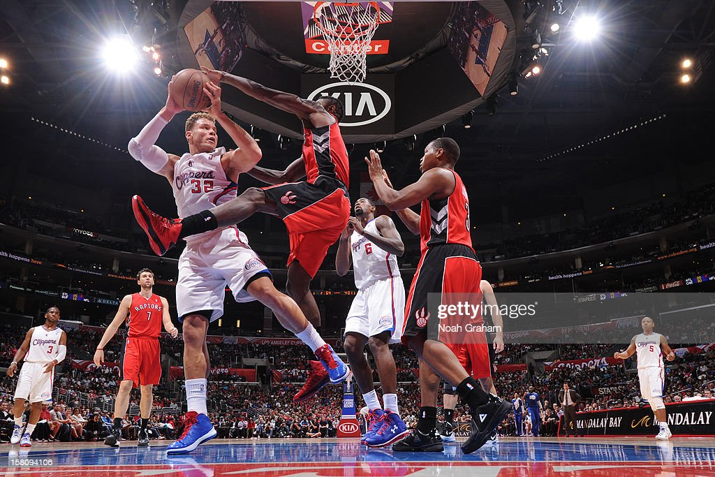 The Toronto Raptors attempt to block a shot by <a gi-track='captionPersonalityLinkClicked' href=/galleries/search?phrase=Blake+Griffin+-+Basketball+Player&family=editorial&specificpeople=4216010 ng-click='$event.stopPropagation()'>Blake Griffin</a> #32 of the Los Angeles Clippers on December 9, 2012 at the Staples Center in Los Angeles, California.