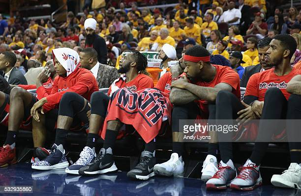 The Toronto Raptors bench including DeMarre Carroll Patrick Patterson and Terrence Ross react during the second half against the Cleveland Cavaliers...