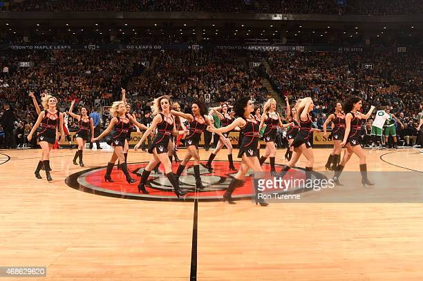 The Toronto Raptors dance team performs during a game against the Boston Celtics on April 4 2015 at the Air Canada Centre in Toronto Ontario Canada...