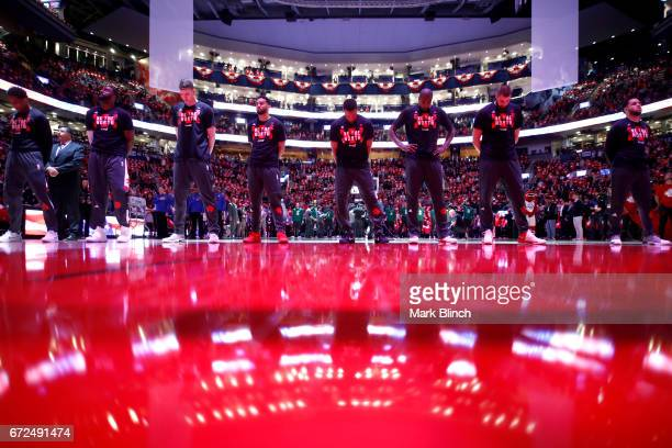 The Toronto Raptors honor the National Anthem before the game against the Milwaukee Bucks during Game Five of the Eastern Conference Quarterfinals of...