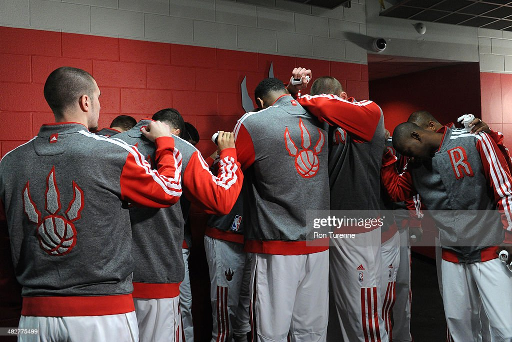 The Toronto Raptors huddle before the game against the Boston Celtics on March 28, 2014 at the Air Canada Centre in Toronto, Ontario, Canada.