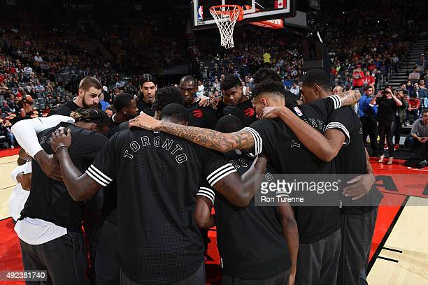 The Toronto Raptors huddle before the game against the Minnesota Timberwolves on October 12 2015 at the Air Canada Centre in Toronto Ontario Canada...