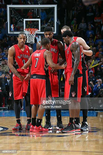 The Toronto Raptors huddle during the game against the Oklahoma City Thunder on December 22 2013 at the Chesapeake Energy Arena in Oklahoma City...