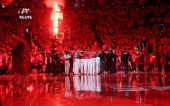 The Toronto Raptors huddle prior to play against the Brooklyn Nets in Game Seven of the NBA Eastern Conference Quarterfinals at the Air Canada Centre...