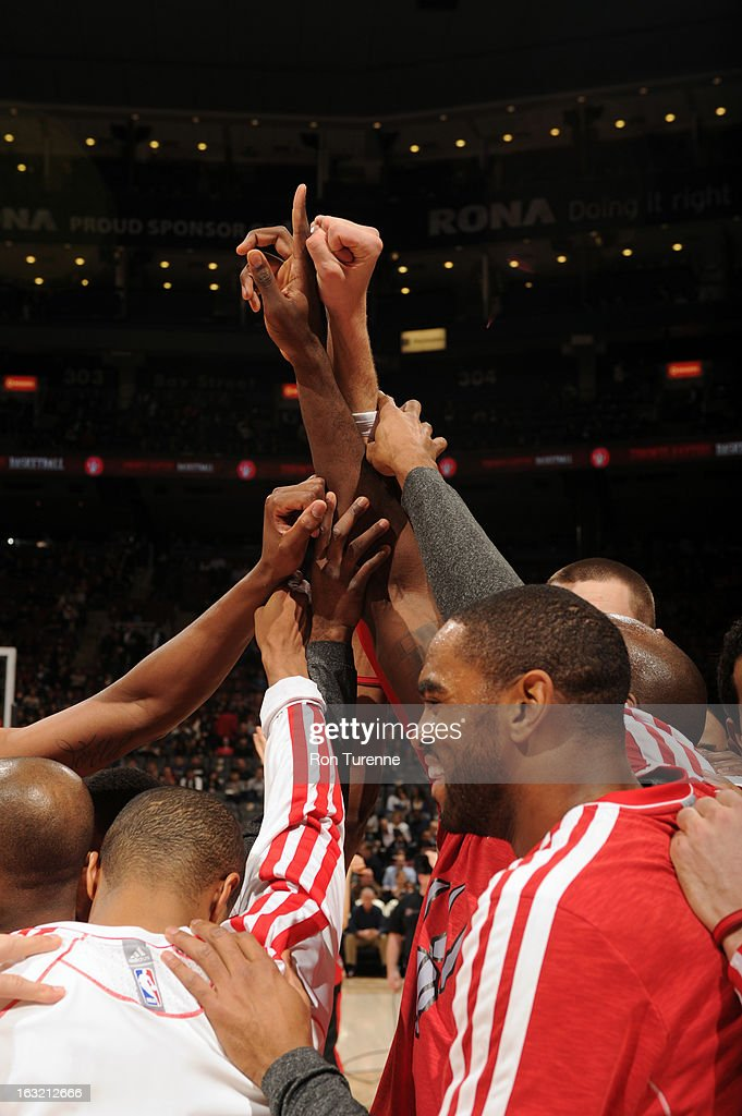 The Toronto Raptors huddle up before the game against the Washington Wizards on February 25, 2013 at the Air Canada Centre in Toronto, Ontario, Canada.