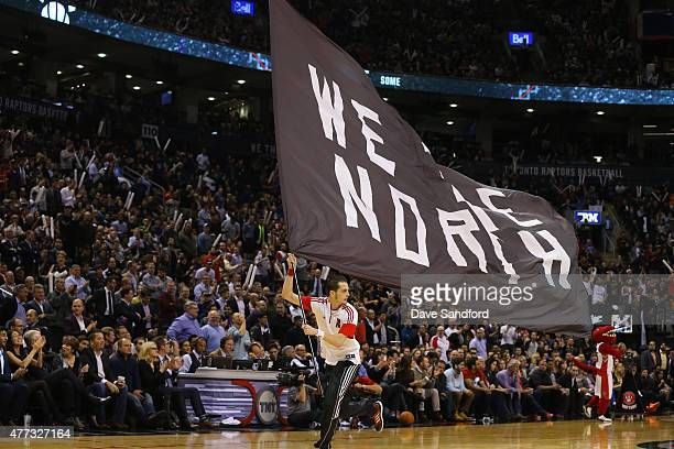 The Toronto Raptors hype team gets the fans into the game against the Chicago Bulls at the Air Canada Centre on November 13 2014 in Toronto Ontario...