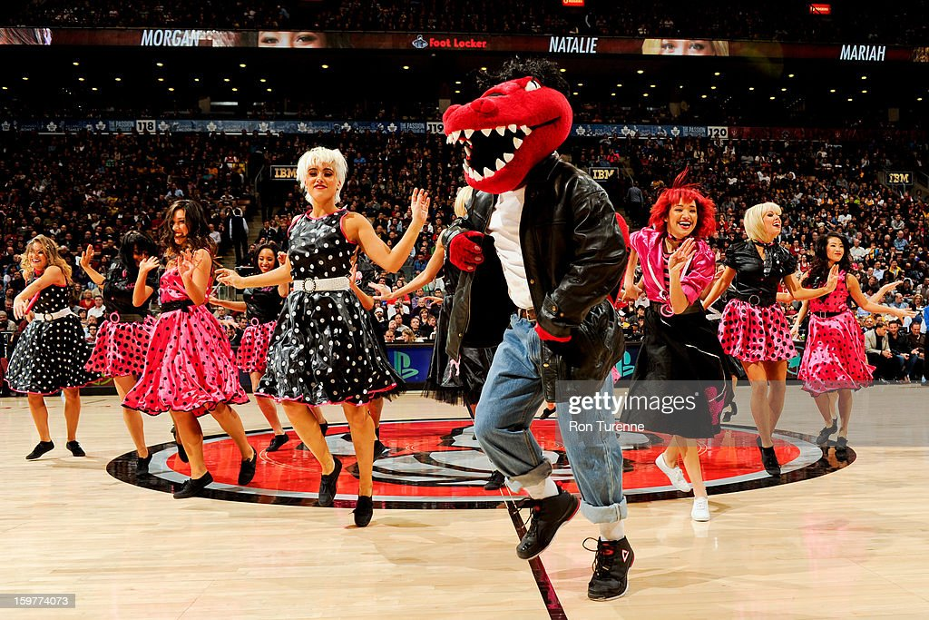 The Toronto Raptors mascot performs with the Raptors Dance Pak during a game against the Los Angeles Lakers on January 20, 2013 at the Air Canada Centre in Toronto, Ontario, Canada.
