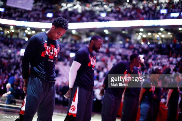 The Toronto Raptors stand for a moment of silence for the National Anthem before the game against the Cleveland Cavaliers in Game Three of the...