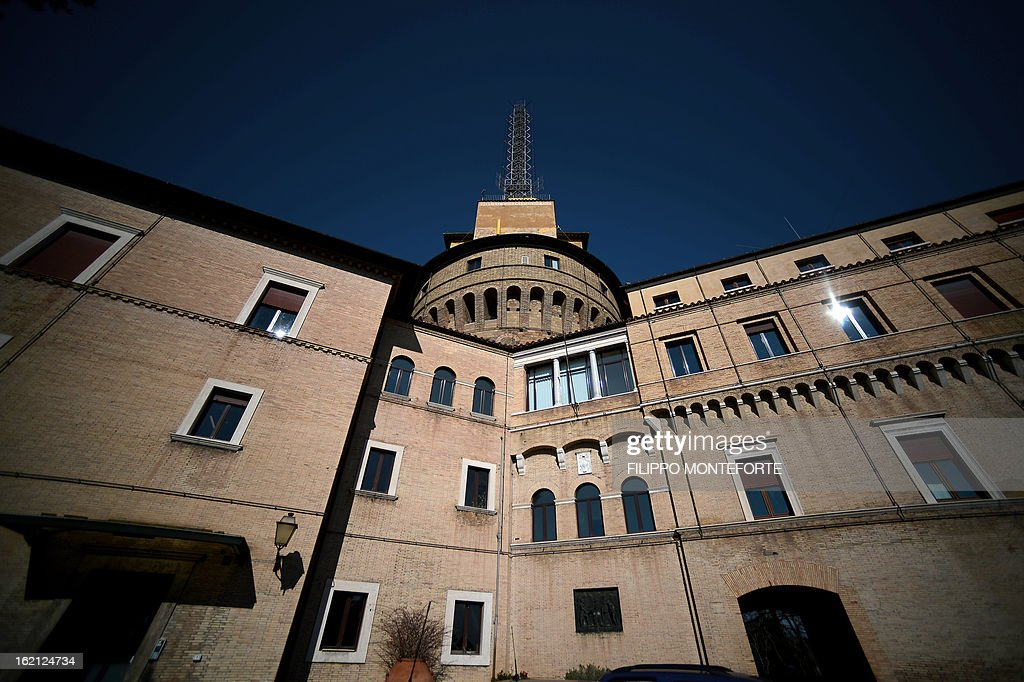 The Torre dei Venti with the radio antenna, the historical Radio Vaticana venue is seen inside the Vatican City State on February 18, 2013. Pope Benedict XVI will be hosted in the convent of Mater Ecclesiae (Mother of the Church) offering him a substantial four-story modern home complete with contemporary chapel, garden and a roof terrace looking out from a rise dominated by the Holy See's TV transmission tower. Pope Benedict XVI began a week-long spiritual retreat out of the public eye on Monday ahead of his resignation on February 28 with the field of candidates to succeed him still wide open. AFP PHOTO/ Filippo MONTEFORTE