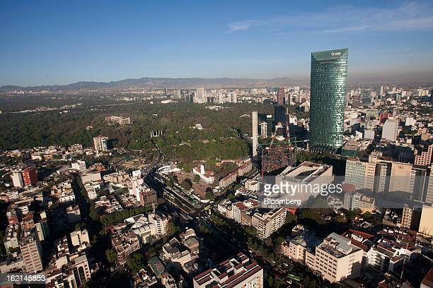 The Torre Mayor building right stands near Chapultepec Park center in this aerial photograph taken from a helicopter in the Condor Group a fleet of...