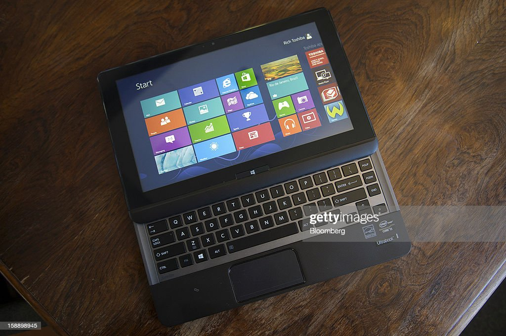 The Toshiba Corp. Satellite U925t Ultrabook is arranged for a photograph in San Francisco, California, U.S., on Thursday, Dec. 27, 2012. Toshiba's Satellite U925t Ultrabook runs on Microsoft Corp.'s Windows 8 operating system. Photographer: David Paul Morris/Bloomberg via Getty Images