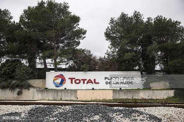 The Total logo sits on a sign as it stands beside railway tracks near La Mede oil refinery operated by Total SA in La Mede France on Saturday Dec 19...