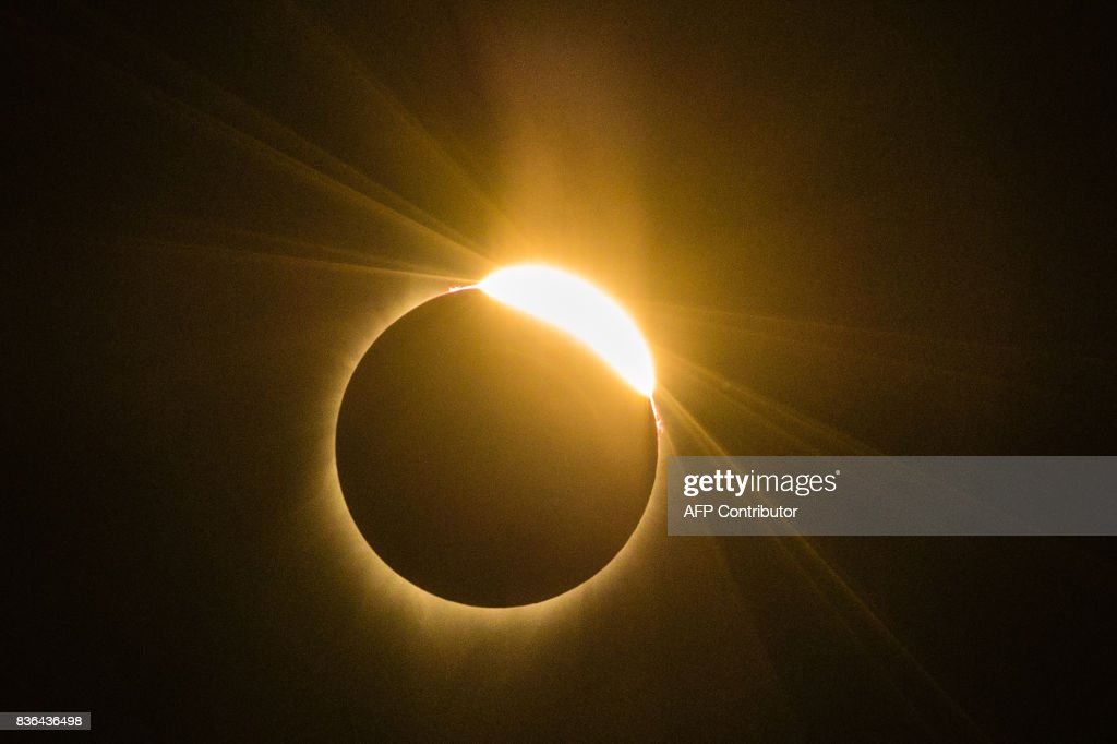 TOPSHOT - The total solar eclipse Monday August 21, 2017 in Madras, Oregon. Emotional sky-gazers stood transfixed across North America Monday as the Sun vanished behind the Moon in a rare total eclipse that swept the continent coast-to-coast for the first time in nearly a century. /