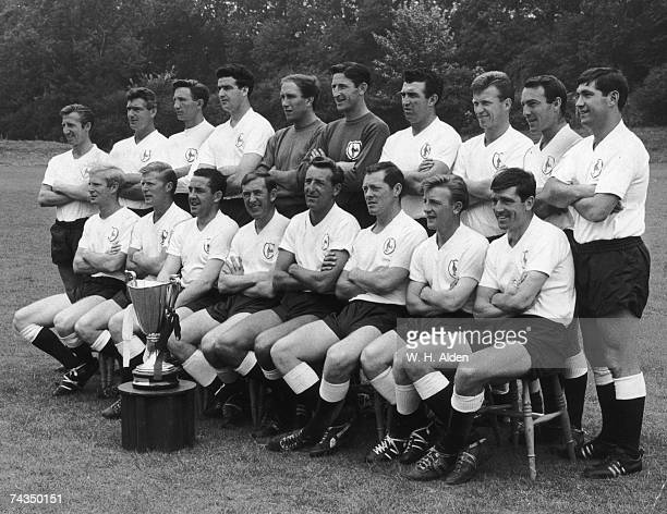 The Tottenham Hotspur football team pose with the European Cup Winners Cup 2nd August 1963 From left to right Cliff Jones Ron Henry Melvyn Hopkins...