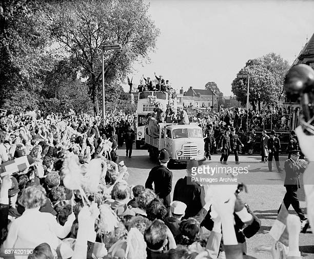 The Tottenham Hotspur players parade the FA Cup and League Championship trophies through London on an opentopped bus after wrapping up The Double by...