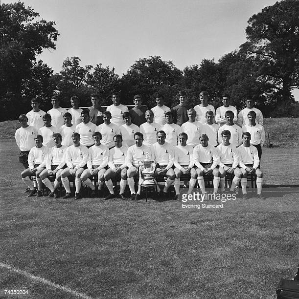 The Tottenham Hotspur squad posing with the FA Cup 9th August 1967 Back row from left to right Jimmy Pearce Roger Hoy Roy Henry Roy Brown Mike...