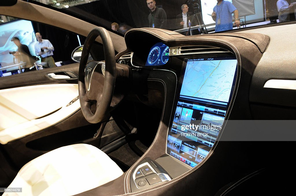 The touch-screen control panel of the new Tesla Model S all-electric sedan (L), at the car's unveiling in Hawthorne, California on March 26, 2009. Musk said the state-of-the-art, five-seat sedan will be the world's first mass-produced, highway-capable electric car. The car has an anticipated base price of 57,400 US dollars but will cost less than 50,000 after a federal tax credit of 7,500 dollars. AFP PHOTO / Robyn BECK