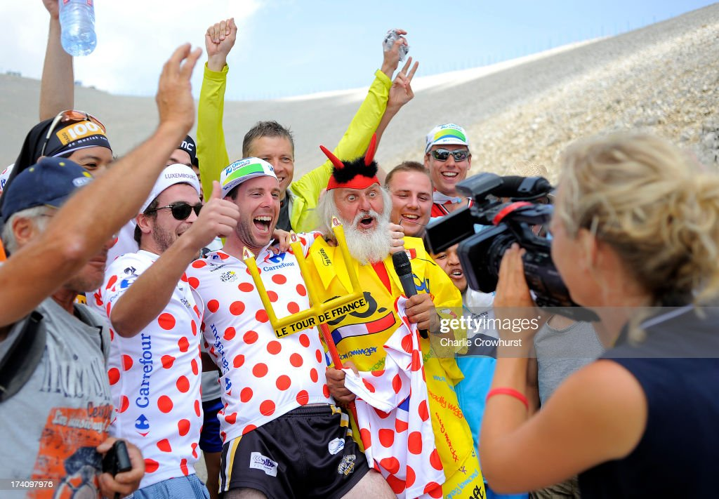 The Tour De France Devil is mobbed by spectators during stage fifteen of the 2013 Tour de France, a 242.5KM road stage from Givors to Mont Ventoux, on July 14, 2013 on Mont Ventoux, France.