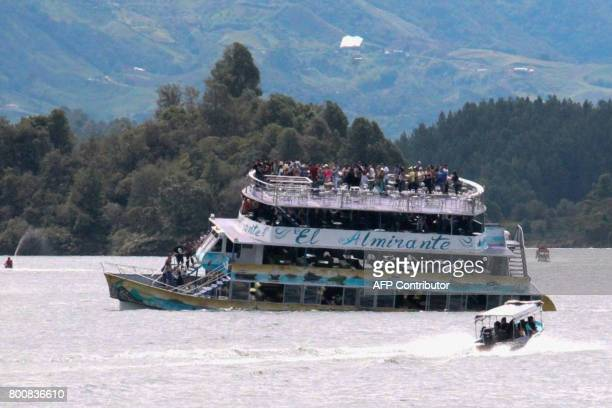 TOPSHOT The tourist boat Almirante is seen in the Reservoir of Penol in Guatape municipality in Antioquia on June 25 2017 At least nine people were...
