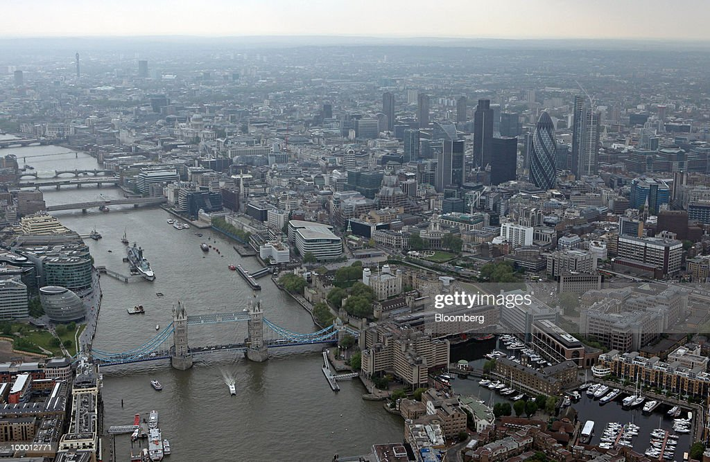The Tower Bridge and the River Thames are seen in London, U.K., on Wednesday, May 19, 2010. Job vacancies at London financial-services companies fell 12 percent in April as Britain headed into elections that resulted in a coalition government and the European Union struggled to cut deficits. Photographer: Chris Ratcliffe/Bloomberg via Getty Images