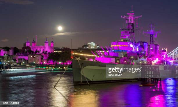 The Tower of London and HMS Belfast are Illuminated pink for Breast Cancer Campaign's 'Turn London Landmarks Pink' for breast cancer awareness month...