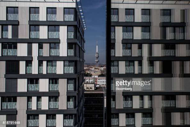 The Tower Park Prague stands beyond newly built apartment blocks built by Central Group AS in the Zizkov district of Prague Czech Republic on Tuesday...