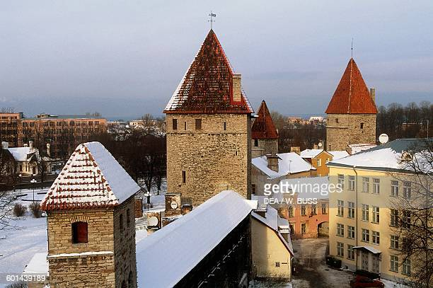 The towers along the walls of Tallinn's old town under the snow Estonia 13th century