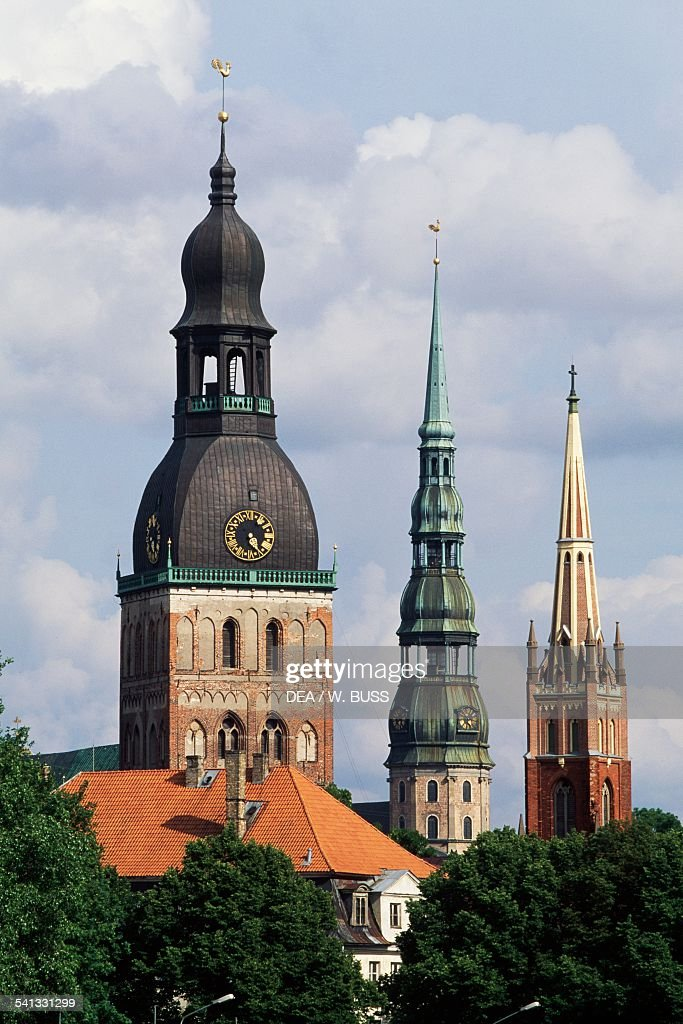 The towers of the cathedral on the left St Peter's church in the centre and St Saviour's Anglican Church on the right historic centre of Riga Latvia