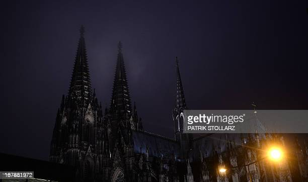 The towers of the Cologne cathedral are pictured on November 7 2013 in Cologne western Germany AFP PHOTO / PATRIK STOLLARZ